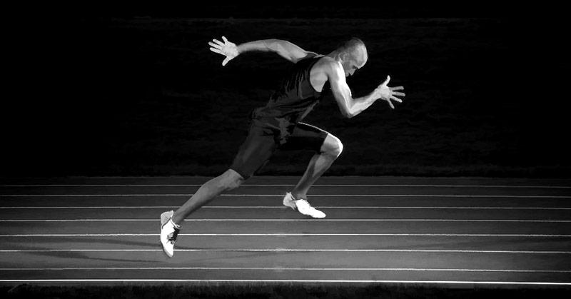 Track Athlete Sprinting at Maximum Velocity